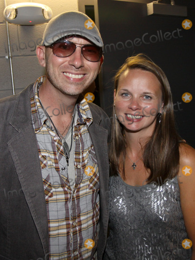 Rhett Akins Photo - August 16 2011 - Athens GA - Corey Smith and Melissa Christian wife of slain officer Country artist Colt Ford rounded up his songwriter and artist friends to hold a benefit for the family of Elmer Buddy Christian an Athens Police Officer who died in the line of duty  On hand were Jason Aldean Edwin McCain Rhett Akins Dallas Davidson James Otto Rachel Farley Corey Smith Brantley Gilbert and Mike Dekel The performance was held for a packed house at the reconstructed and recently reopened Georgia Theater Photo credit Dan HarrAdMedia