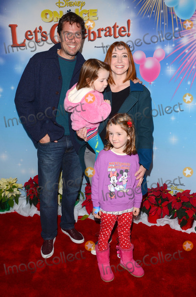Alyson Hannigan Photo - 11 December 2014 - Los Angeles California - Alexis Denisof Alyson Hannigan Arrivals for Disney On Ice presents Lets Celebrate held at Staples Center in Los Angeles Ca Photo Credit Birdie ThompsonAdMedia