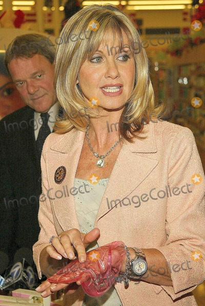Olivia Newton-John Photo - Dr Ernie Bodai and Olivia Newton-John at the sale of the Official Breast Cancer Awareness Postage Stamp  Breast Self-Exam Liv Kit at the Burbank Savon Burbank CA 10-07-04