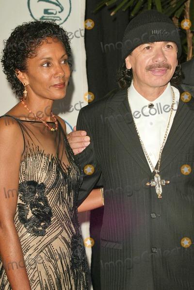 Carlos Santana Photo - Carlos Santana and his wife Deborah at the 2004 Latin Recording Academy Person of the Year Tribute to Carlos Santana at the Century Plaza Hotel Century City CA 08-30-04