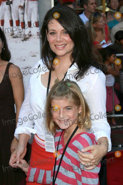 Meredith Salenger Photo - Meredith Salenger and guest at the world premiere of The Game Plan El Capitan Theater Hollywood CA 09-23-07