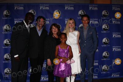 Ann Dowd Photo - Omar Sy Ezra Miller Ann Dowd Quvenzhane Wallis Elle Fanning Eddie Redmayneat the Santa Barbara International Film Festivals 2013 Virtuosos Award Arlington Theater Santa Barbara CA 01-29-13