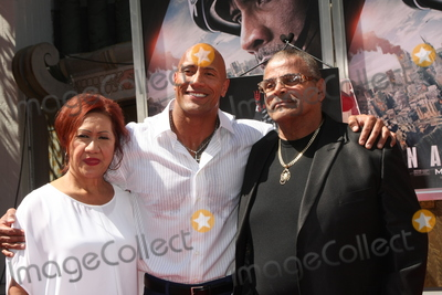 Ata Johnson Photo - LOS ANGELES - MAY 19  Ata Johnson Dwayne Johnson Rocky Johnson at the Dwayne Johnson Hand and Foot Print Ceremony at the TCL Chinese Theater on May 19 2015 in Los Angeles CA
