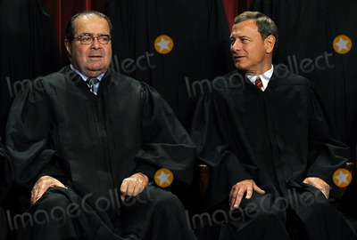 Antonin Scalia Photo - Chief Justice John G Roberts (R) chats with Associate Justice Antonin Scalia as the Supreme Court Justices of the United States sit for a formal group photo in the East Conference Room of the Supreme Court in Washington on Friday October 8 2010     Credit Roger L Wollenberg - Pool via CNP