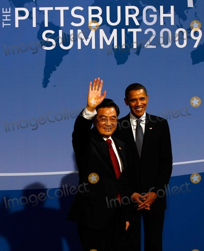 Hu Jintao Photo - Pittsburgh PA - September 24 2009 -- United States President Barack Obama (R) welcomes Chinese President Hu Jintao to the welcoming dinner for G-20 leaders at the Phipps Conservatory on Thursday September 24 2009 in Pittsburgh Pennsylvania Heads of state from the worlds leading economic powers arrived today for the two-day G-20 summit held at the David L Lawrence Convention Center aimed at promoting economic growth Photo by Win McNameePool-CNP-PHOTOlinknet