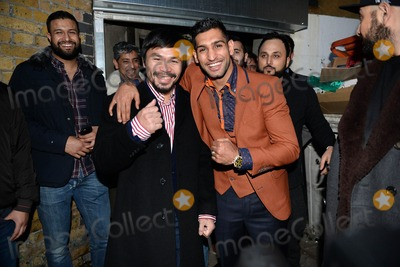 Amir Khan Photo - Photo by KGC-42starmaxinccomSTAR MAX2015ALL RIGHTS RESERVEDTelephoneFax (212) 995-119612315Professional boxers Manny Pacquiao and Amir Khan meet at the Fitzroy Lodge Amateur Boxing Club to discuss a potential prizefighting bout(South London England UK)