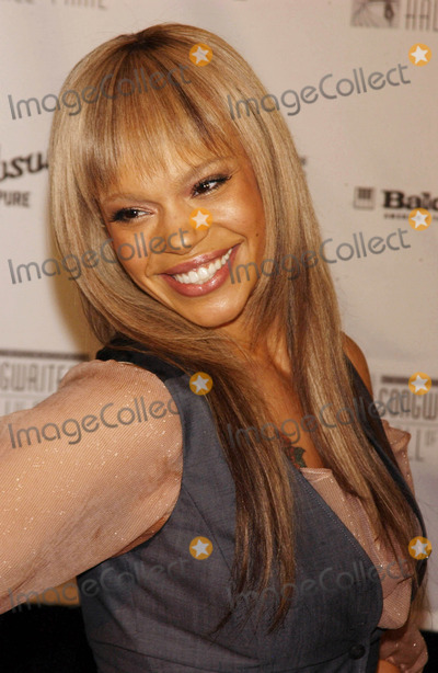 Faith Evans Photo - Photo by Walter Weissmanstarmaxinccom20056905Faith Evans at the 36th Annual Songwriters Hall of Fame(NYC)