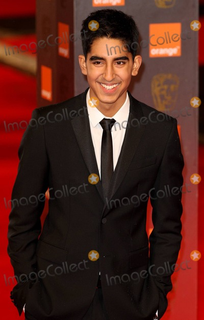 Dev Patel Photo - Dev Patel poses for photographers on the red carpet at the 2011 Orange British Academy Film Awards held at The Royal Opera House in Covent Garden London UK 021311
