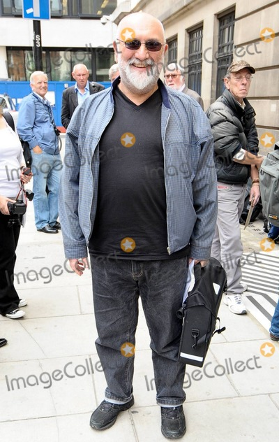 Alexis Sayle Photo - Comedian-turned-writer Alexie Sayle poses outside the BBC where he made an appearance to promote his new book Stalin Ate My Homework which is a memoir of his childhood in Liverpool Sayle appeared in the groundbreaking 80s series The Young Ones London UK 9910