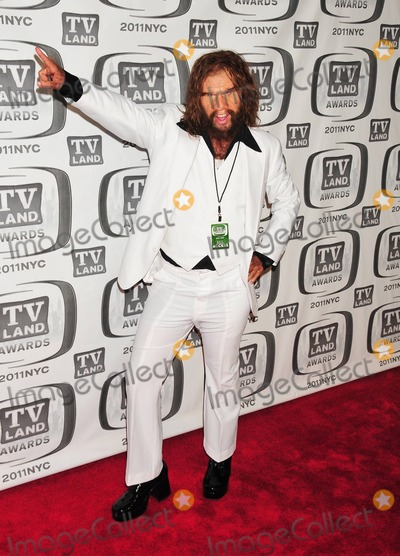 GEICO CAVEMAN Photo - GEICO Caveman poses on the red carpet at the 9th Annual TV Land Awards held at the Javits Center New York NY 041011