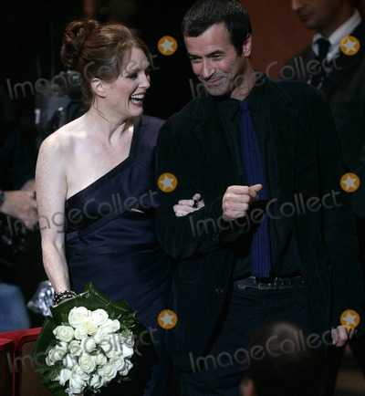 Andrea Occhipinti Photo - American actress Julianne Moore and Italian actor Andrea Occhipinti laugh during a ceremony honoring Moore with the Marcaurelio Acting Award during the 5th International Rome Film Festival  Rome ITA 110210