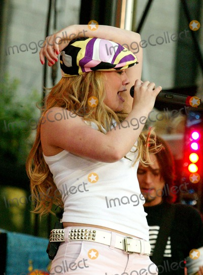 Hilary Duff Photo - Hilary Duff Performing on Abc Good Morning Americas 2004 Summer Concert Series at Bryant Park in New York City on July 16 2004 Photo by Henry McgeeGlobe Photos Inc 2004