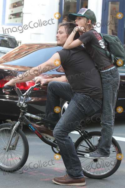 Norman Reedus Photo - NYC  050110EXCLUSIVE Norman Reedus with his son Mingus Reedus (his mother is Helena Christensen) standing on the back of his bicycle while riding around in SOHOEXCLUSIVE photo by Adam Nemser-PHOTOlinknet
