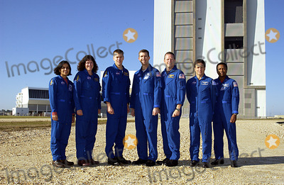 Kalpana Chawla Photo - FILE PHOTO KENNEDY SPACE CENTER FLA -- The STS-107 crew poses for a group portrait with the Vehicle Assembly Building in the background They are at KSC to take part in Terminal Countdown Demonstration Test activities a standard part of launch preparations From left to right are Mission Specialists Kalpana Chawla and Laurel Clark Pilot William Willie McCool Commander Rick Husband Mission Specialist David Brown Payload Specialist Ilan Ramon (the first Israeli astronaut) and Payload Commander Michael Anderson STS-107 is a mission devoted to research and will include more than 80 experiments that will study Earth and space science advanced technology development and astronaut health and safety Launch is targeted for Jan 16 2003 between 10 am and 2 pm EST Supplied by NASANY Photo Press       NY Photo Press    phone (646) 267-6913     e-mail infocopyrightnyphotopresscom