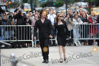 Renee Zellweger Photo - May 2 2014 New York CityDoyle Bramhall II and Renee Zellweger attending a memorial service for L Wren Scott at St Bartholomews Church in New York City on May 2 2014