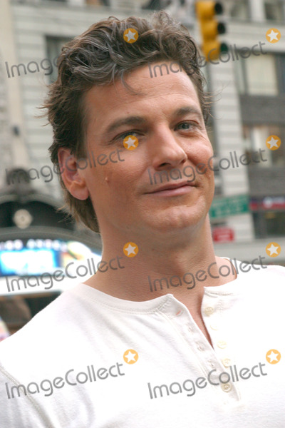 ADAM STORKE Photo - Hallmark Channel pulled quite a publicity stunt in Times Square to promote their latest western miniseries Johnson County War They have arranged cattle parade in Times Square with cowboys led by Tom Berenger and Adam Storke on horseback New York August 19 2002