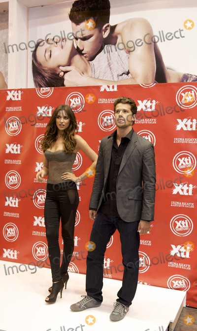 Arthur Sales Photo - Sports Illustrated swimsuit model Irina Shayk (L) and Brazilian model Arthur Sales at the launch of the new Xti 2011-2012 shoes collection at IFEMA on March 14 2011 in Madrid Spain