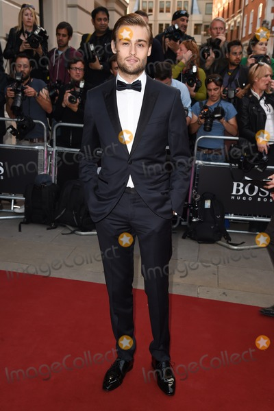Douglas Booth Photo - Douglas Booth arriving for the GQ Men Of The Year Awards 2014 at the Royal Opera House London 02092014 Picture by Steve Vas  Featureflash