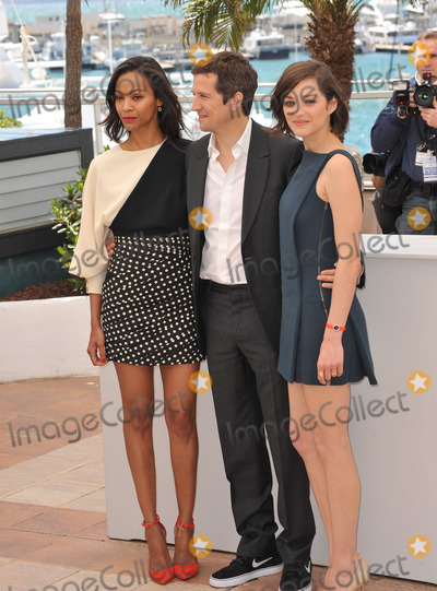 Zoe Saldana Photo - Zoe Saldana Marion Cotillard (right)  director Guillaume Canet at the photocall for their movie Blood Ties at the 66th Festival de CannesMay 20 2013  Cannes FrancePicture Paul Smith  Featureflash