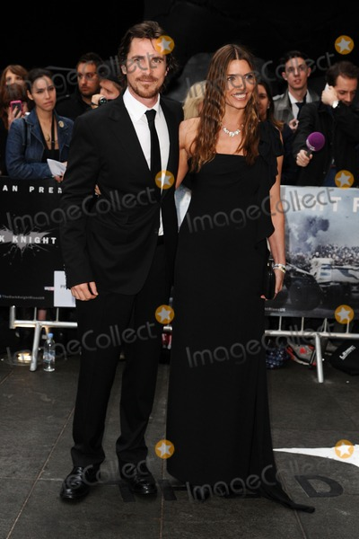 Christian Bale Photo - Christian Bale and wife arriving for European premiere of The Dark Knight Rises at the Odeon Leicester Square London 18072012 Picture by Steve Vas  Featureflash