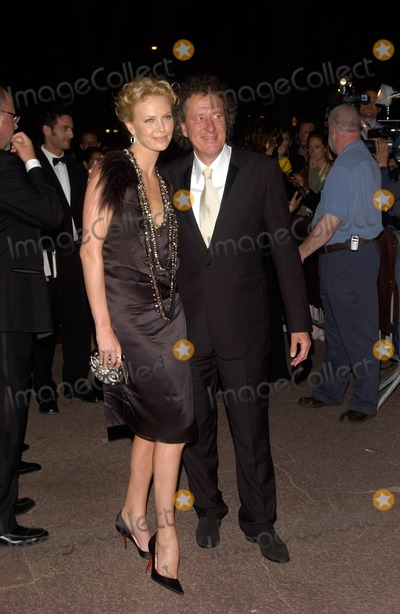 Geoffrey Rush Photo - GEOFFREY RUSH  CHARLIZE THERON at the party in Cannes following the gala screening of their new movie The Life  Death of Peter SellersMay 21 2004