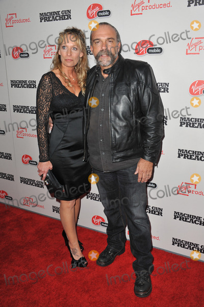 Sam Childers Photo - Sam Childers (upon whom the movie is based)  wife Linda at the Los Angeles premiere of his new movie Machine Gun Preacher at the Academy of Motion Picture Arts  Sciences Theatre Beverly HillsSeptember 21 2011  Los Angeles CAPicture Paul Smith  Featureflash