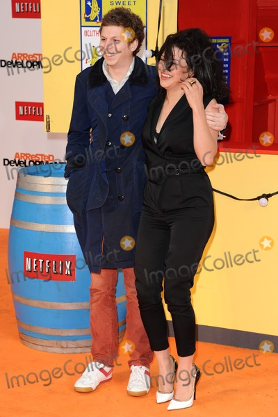 Arrested Development Photo - Michael Cera and Alia Hawkat arriving for the Arrested Development Season Four  premiere at the Vue Leicester Square London 09052013 Picture by Steve Vas  Featureflash