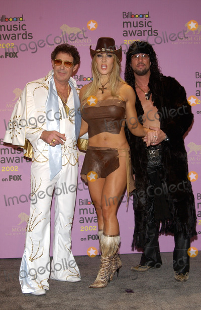 Joanie Laurer Photo - Actor BARRY WILLIAMS (left) with wrestler JOANIE LAURER (CHYNNA)  fianc SHAWN WALDMAN (SIXPACK) at the 2002 Billboard Music Awards at the MGM Grand Las Vegas09DEC2002 Paul Smith  Featureflash