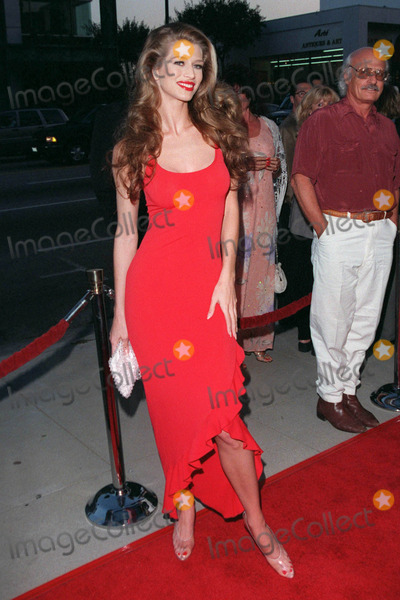 Dean Martin Photo - 18AUG98  Actressmodel AMBER SMITH at the Beverly Hills premiere of HBOs The Rat Pack The movie is based on the lives of Frank Sinatra Dean Martin Peter Lawford  Joey Bishop