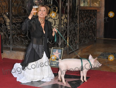 Emma Thompson Photo - Actress Emma Thompson on Hollywood Boulevard where she was honored with the 2416th star on the Hollywood Walk of Fame The star is located outside The Pig n Whistle British pub Her new movie Nanny McPhee Returns opens in the USA on August 20th The pig co-stars in the movieAugust 6 2010  Los Angeles CAPicture Paul Smith  Featureflash