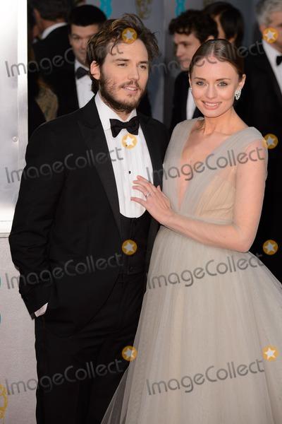 Sam Claflin Photo - Sam Claflin and Laura Haddock arrives for the BAFTA Film Awards 2015 at the Royal Opera House London 08022015 Picture by Steve Vas  Featureflash