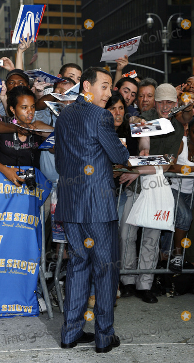 Pee-wee Herman Photo - Paul Reubens aka Pee Wee Herman signs autographs outside The Late Show With David Letterman on July 11 2006 in New York City