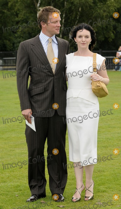 Rupert Penry-Jones Photo - Windsor UK Rupert Penry Jones and Dervla Kirwan in the Smiths Lawn Enclosure at the Cartier International Polo held at the Guards Polo Club in Windsor Great Park26 July 2009Can NguyenLandmark Media