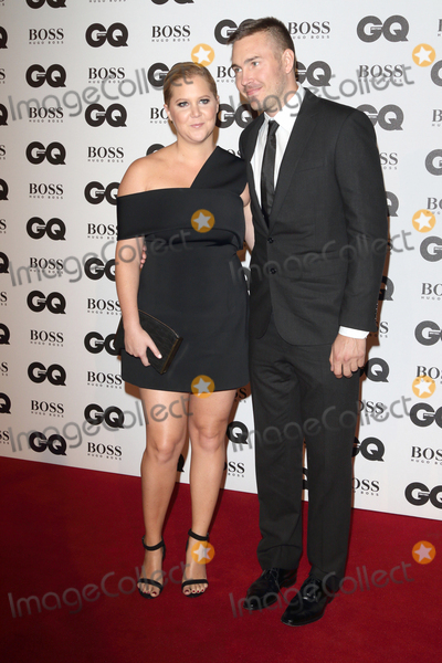 Amy Schumer Photo - LondonUK  Amy Schumer and Ben Hanisch at the GQ Men of the Year Awards 2016 - in association with Hugo Boss - at the  Tate Modern Bankside London 6th September 2016RefLMK73-61345-070916Keith MayhewLandmark MediaWWWLMKMEDIACOM