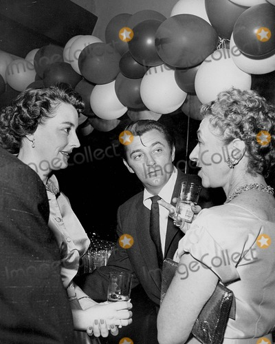 Robert Mitchum Photo - Robert Mitchum with Dorothy Mitchum at the Party For Rory Supplied by Globe Photos Inc