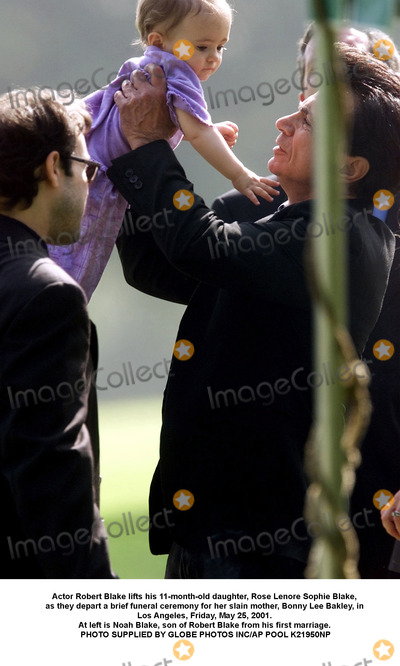 Bonnie Lee Bakley Photo - Actor Robert Blake lifts his 11-month-old daughter Rose Lenore Sophie Blake as they depart a brief funeral ceremony for her slain mother Bonny Lee Bakley in Los Angeles Friday May 25 2001 At left is Noah Blake son of Robert Blake from his first marriage PHOTO SUPPLIED BY GLOBE PHOTOS INCAP POOL K21950NP