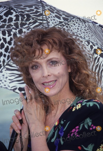 Tina Louise Photo - Tina Louise with Herself Designed Umbrella A7345 Waters Edge Party 1991 Photo by Adam Scull-Globe Photos Inc