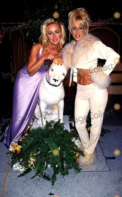 Mindy McCready Photo - 31st Cma Awards Mindy Mccready and Lorrie Morgan Photo Lisa Rose  Globe Photos Inc