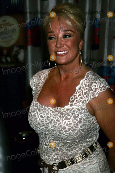 Karen Will Rogers Photo - K37860RMTANYA TUCKER MAKES A SPECIAL APPEARANCE AT PLANET HOLLYWOOD FOR A BOOK SIGNING TO HELP PHOTOGRAPHER KAREN WILL ROGERS AND LAURA LACY PROMOTE THEIR BOOK MUSIC ROW DOGS AND NASHVILLE CATS TIMES SQUARE NEW YORK CITY 06152004PHOTO BY RICK MACKLERRANGEFINDERSGLOBE PHOTOS 2004TANYA TUCKER