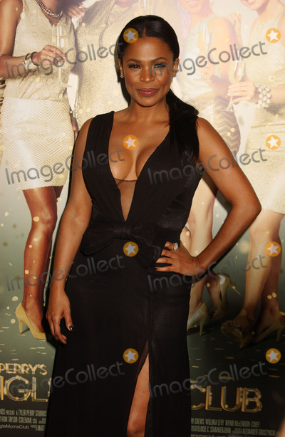 Nia Long Photo - Nia Long attends the Premiere of the Single Moms Club at the Arclight Theater in Hollywoodca on March 102014 Photo by Phil Roach-ipoll-Globe Photos