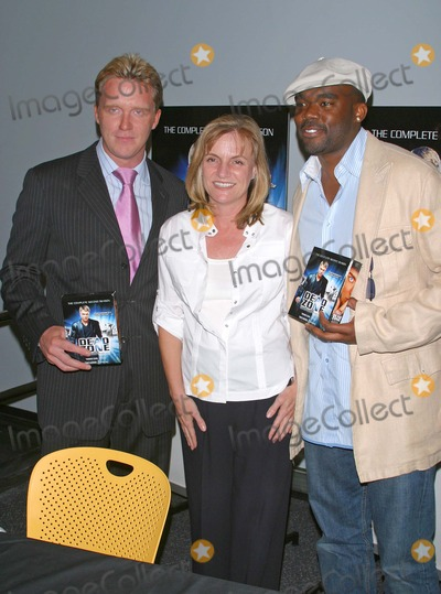 Anne Parducci Photo - Lions Gate Home Entertainments Dvd Release of the Dead Zone Best Buy Store Los Angeles CA (06102004) Photo by Milan RybaGlobe Photos Inc2004 Anthony Michael Hall Anne Parducci ( Vice President Lions Gate) John Adams