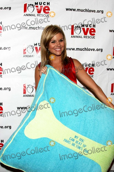 Tiffany Photo - TIFFANI THIESSEN WITH A DOG BED -MY DOG CAN BEAT UP PARIS HILTONS DOG MESSAGE ON THE BONE -MUCH LOVE ANIMAL RESCUE 4TH ANNUAL CELEBRITY COMEDY BENEFIT AT THE LAUGH FACTORY -WEST HOLLYWOOD CA -08-10-2005 -PHOTO BY NINA PROMMERGLOBE PHOTOS INC2005 -K44283NP
