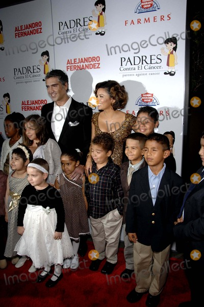 Alejandro Fernandez Photo - Alejandro Fernandez and Eva Longoria Parker during the Padres Contra El Cancers 8th Annual El Sueno De Ezperanza Benefit Gala held at the Hollywood  Highland Center Grand Ballroom on October 7 2008 in Los AngelesPhoto Michael Germana - Globe Photos Inc  2008K59992