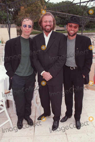 The Bee GEES Photo - 0497 the Bee Gees Attend the Monte Carlo Music Awards 1997 -It Is Reported That Maurice Gibb Is Critically Ill After a Suspected Heart Attack- Mauricegibbretro