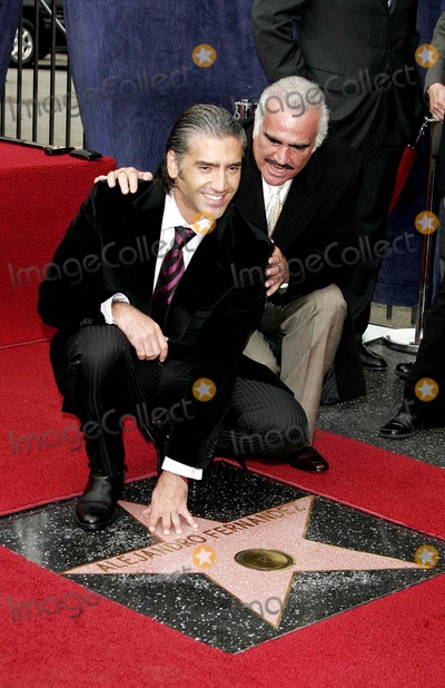 Vicente Fernandez Photo - ALEJANDRO FERNANDEZ JR AND HIS FATHER VICENTE FERNANDEZ WHOSE STAR IS NEXT TO HIS -ALEJANDRO FERNANDEZ JR IS HONORED WITH THE 2296TH STAR ON THE HOLLYWOOD WALK OF FAME -6160 HOLLYWOOD BOULEVARD HOLLYWOOD CALIFORNIA - 12-02-2005 -PHOTO BY NINA PROMMERGLOBE PHOTOS INC 2005K45867NP