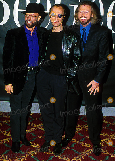 Bee Gees Photo - Bee Gees at Press Conference to Announce Their One Night Only Concert Dates  London Enland 6021998 Photo Uppa Ipol Globe Photos Inc 1998 Bee Gees Maurice Barry and Robin Gibb Mauricegibbretro