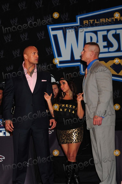 Michael Cole Photo - Dwayne the Rock Johnson Nicole Snookie Polizzi John Cena Wwe Press Conference For Wrestlemania Xxvii Hard Rock Cafe New York City 03-30-2011 photo by Ken Babolcsay - Ipol- Globe Photos Inc