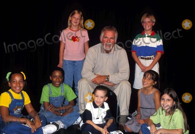 Kenny Rogers Photo - Kenny Rogers Auditioning Children For Chrismas From the Heart at Producers Club New York City K13342ww 09171998 Photo by Walter WeissmanGlobe Photos Inc