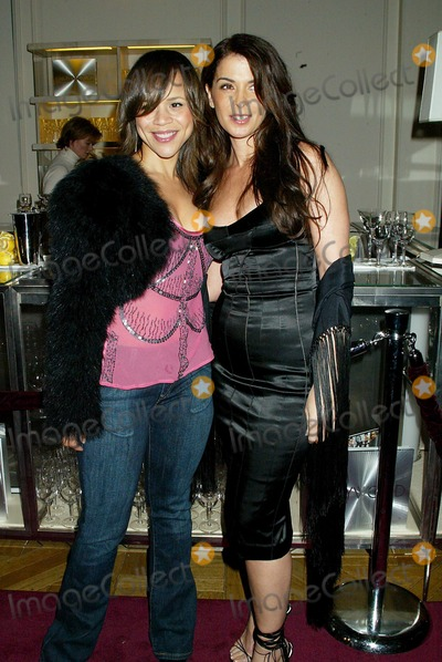 ANABELLA SCIORRA Photo - Dolce  Gabbanas Book Party For Their Book Hollywood Bergdorf Goodman New York City Photo Sonia Moskowitz  Globe Photos Inc 2003 10292003 Rosie Perez and Anabella Sciorra