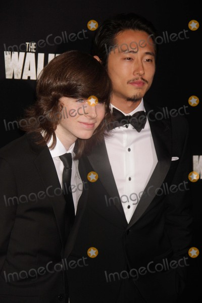 Chandler Riggs Photo - Chandler Riggs Steven Yeun at Amc Season Six Debut of the Walking Dead at Fan Premiere Event at Madison Square Garden 10-9-2015 John BarrettGlobe Photos